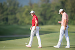 Peter Uihlein of USA (in pink) and Danny Willett of England (in red) on the green during the 58th UBS Hong Kong Golf Open as part of the European Tour on 11 December 2016, at the Hong Kong Golf Club, Fanling, Hong Kong, China. Photo by Marcio Rodrigo Machado / Power Sport Images
