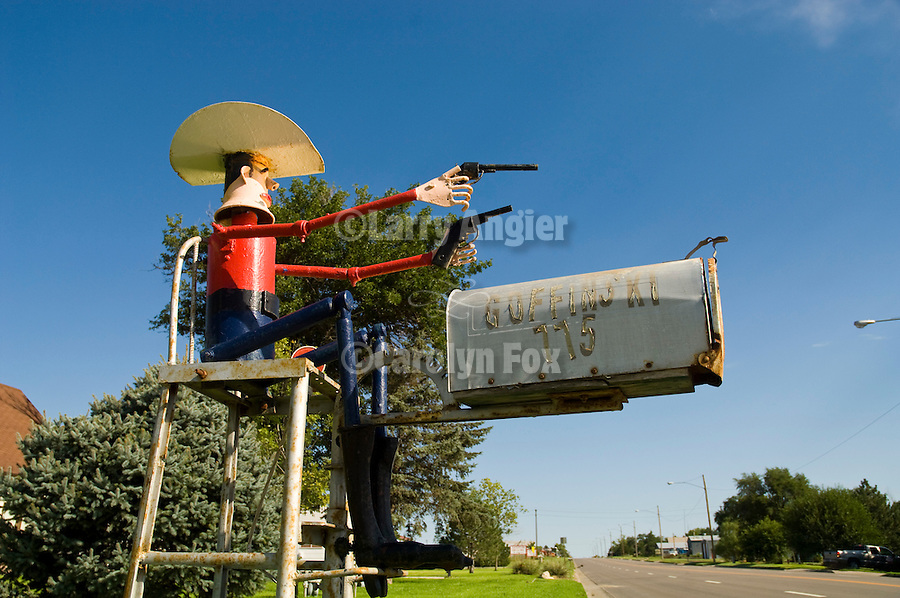 Two-gun cowboy mail box of the Guffinski family in Hill City, Kansas.