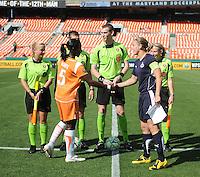 Washington Freedom  defender Cat  Whitehill  (4) and Sky Blue FC defender Anita Asante (5) shake hands before the coin toss.  Washington Freedom defeated Skyblue FC 2-1 at RFK Stadium, Saturday May 23, 2009.