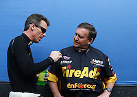 Feb 22, 2015; Chandler, AZ, USA; NHRA top fuel driver Clay Millican (left) talks with pro stock driver Larry Morgan during the Carquest Nationals at Wild Horse Pass Motorsports Park. Mandatory Credit: Mark J. Rebilas-