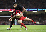 All Blacks wing Julian Savea tackles Wales full back Leigh Halfpenny.<br /> Dove men Series 2014<br /> Wales v New Zealand<br /> 22.11.14<br /> ©Steve Pope -SPORTINGWALES