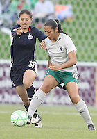 Homare Sawa #10 of the Washington Freedom comes in to challenge Daniela #10 of St. Louis Athletica during a WPS match at the Maryland Soccerplex on May 3, 2009 in Boyds Maryland. The game ended in a 3-3 tie.