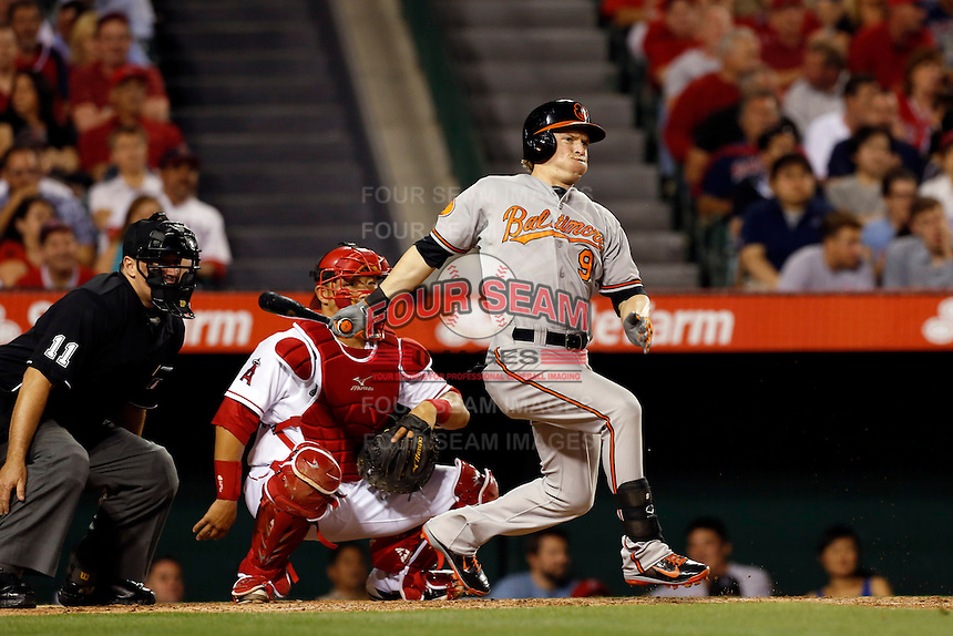 Nate McLouth #9 of the Baltimore Orioles bats in front of catcher Hank Conger and umpire Tony Randazzo against the Los Angeles Angels at Angel Stadium on May 2, 2013 in Anaheim, California. Baltimore defeated Los Angeles 5-1. (Larry Goren/Four Seam Images)