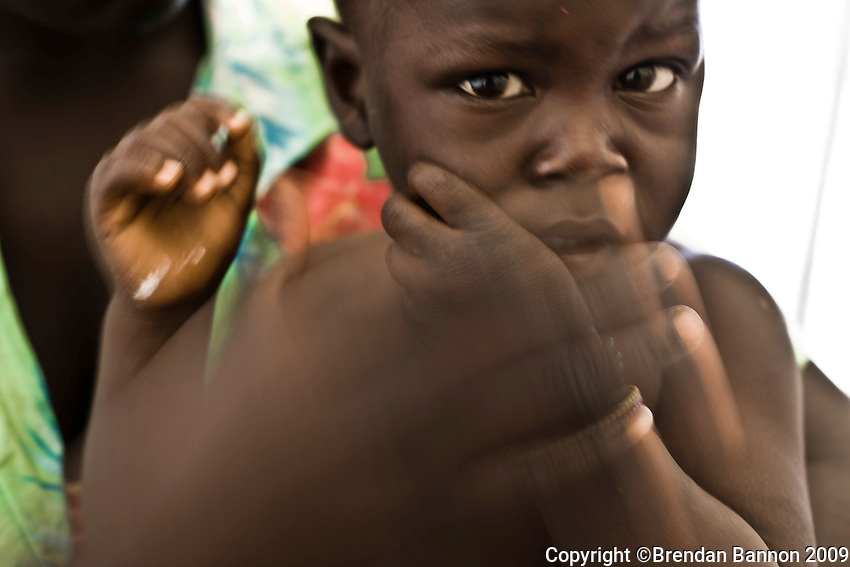 A mother and her sick child in MSf medical center in Nyori refugee camp. Many children in the camp have malaria. the severe cases are kept in the clinic for observation and treatment and released when the fever goes down..