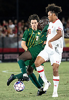 COLLEGE PARK, MD - SEPTEMBER 3: George Mason University defender Jonathan Fawole (27) tackles Maryland University forward Jacen Russell-Rowe (13) during a game between George Mason University and University of Maryland at Ludwig Field on September 3, 2021 in College Park, Maryland.