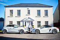 """COPY BY TOM BEDFORD<br /> Pictured: Claire Dix outside her white house with the white cars the family owns, an Audi and a Porche<br /> Re: A home-loving mum is looking forward to a bright 2017 - everything she owns is white.  <br /> Claire Dix, 51, lives in white house where all the inside walls, floors and ceilings are white.<br /> Her furniture is white, her sheets and towels are white - even her Persian cat Mr Darcy is white.<br /> She drives a white Porsche sports car and the other family car is - you've guessed, it white.<br /> And to keep her home spotless she even has a white, limited-edition Dyson cleaner.<br /> Claire said: """"It's not an obsession, just a matter of style - I happen to like white."""