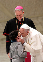 Papa Francesco bacia un bambino durante un incontro con le famiglie numerose in Aula Paolo VI, Citta' del Vaticano, 28 dicembre 2014.<br /> Pope Francis kisses a child during a meeting with large families in the Paul VI hall at the Vatican, 28 December 2014.<br /> UPDATE IMAGES PRESS/Isabella Bonotto<br /> <br /> STRICTLY ONLY FOR EDITORIAL USE
