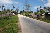 Zanzibar, Tanzania.  Satellite Dish at Village Hut along the Road to Nungwi.