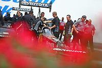 Jun 6, 2015; Englishtown, NJ, USA; Team owner Alan Johnson (right) alongside the dragster of NHRA top fuel driver Shawn Langdon during qualifying for the Summernationals at Old Bridge Township Raceway Park. Mandatory Credit: Mark J. Rebilas-