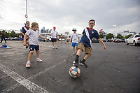 NASHVILLE, TN - SEPTEMBER 5: USA Fans pass a soccer ball before a game between Canada and USMNT at Nissan Stadium on September 5, 2021 in Nashville, Tennessee.