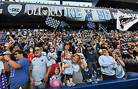 KANSAS CITY, KS - MAY 29: Sporting KC fans celebrate in anticipation before the beginning of the game during a game between Houston Dynamo and Sporting Kansas City at Children's Mercy Park on May 29, 2021 in Kansas City, Kansas.