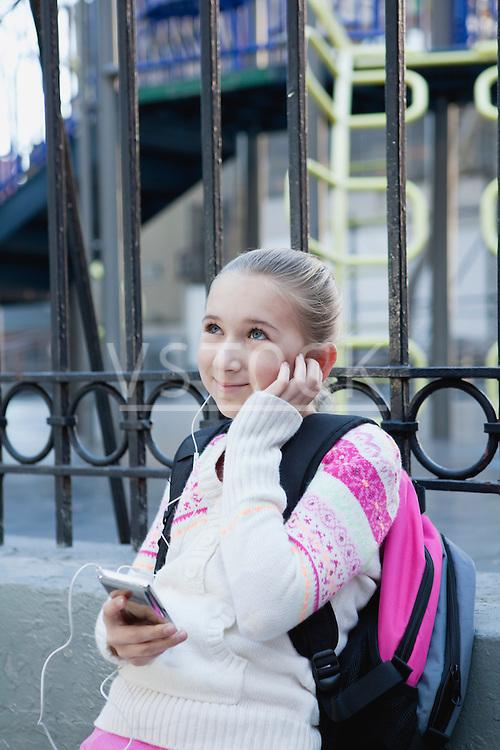 USA, New York State, New York City, Girl (10-11) with earphones listening music