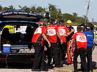 Sept. 22, 2013; Ennis, TX, USA: NHRA top fuel dragster driver Doug Kalitta celebrates with his crew after winning the Fall Nationals at the Texas Motorplex. Mandatory Credit: Mark J. Rebilas-