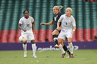 Stephanie HOUGHTON of Great Britain tangles with Hannah WILKINSON of New Zealand - Great Britain Women vs New Zealand Women - Womens Olympic Football Tournament London 2012 Group E at the Millenium Stadium, Cardiff, Wales - 25/07/12 - MANDATORY CREDIT: Gavin Ellis/SHEKICKS/TGSPHOTO - Self billing applies where appropriate - 0845 094 6026 - contact@tgsphoto.co.uk - NO UNPAID USE.