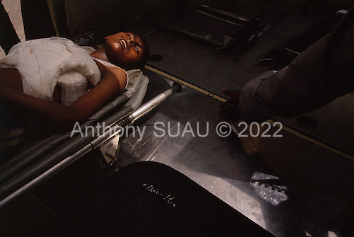Addis Ababa, Ethiopia<br /> May 29, 1991<br /> <br /> A wounded child arrives at the Red Cross/Soviet Hospital after being shot in the streets for opposing the new government.<br /> <br /> In late May 1991 the long civil war in Ethiopia came to a climax when the alliance of four rebel groups, the Ethiopian People's Revolutionary Democratic Front (EPRDF), toppled the authoritarian government of Mengistu Haile-Mariam and took control of Addis Ababa and the nation. The governing regime declared a cease-fire and fled. <br /> <br /> In July 1991 the 24 different groups met in the capital and established a multi-party provisional government headed by Meles Zenawi, the Tigray Rebel Leader, to lead the country to its first free elections within two years.