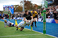 David Strettle of Saracens dives over to score a try during the European Rugby Champions Cup  Round 1 match between Saracens and ASM Clermont Auvergne at the Twickenham Stoop on Saturday 18th October 2014 (Photo by Rob Munro)