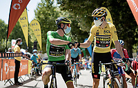 as yellow jersey / GC leader Wout van Aert (BEL/Jumbo - Visma) can't wear 2 jersey's, runner-up  Daryl Impey (ZAF/Mitchelton-Scott) starts this stage in green. <br /> Both are clearly ok with this at the race start in Vienne.<br /> <br /> Stage 2: Vienne to Col de Porte (135km)<br /> 72st Critérium du Dauphiné 2020 (2.UWT)<br /> <br /> ©kramon
