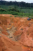 Ouro Verde, Xingu, Brazil. Garimpo illegal gold mine with garimpeiros in muddy water using high pressure hose.