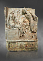 """Roman Sebasteion relief  sculpture of Io and Argos Aphrodisias Museum, Aphrodisias, Turkey.  Against a grey background.<br /> <br /> A powerful hero is folding a sword gazing closely at a half naked and dishevelled young heroine who sits on a chest like stool. Between, on a pillar base stood a small, separately added statue of a goddess ( now missing). The scene follows a scheme used in the relief panels """"Io guarded by Argos"""". Io was one of Zeus's lovers, and Argos was a watchful giant sent to guard her by Hera, Zeus's wife."""