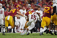 LOS ANGELES, CA - SEPTEMBER 11: Stephen Herron #15 of the Stanford Cardinal tackles Vavae Malepeai #6 of the USC Trojans during a game between University of Southern California and Stanford Football at Los Angeles Memorial Coliseum on September 11, 2021 in Los Angeles, California.