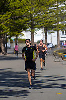People walk and run along Oriental Parade on Easter Monday during lockdown for the COVID19 pandemic in Wellington, New Zealand on Monday, 13 April 2020. Photo: Dave Lintott / lintottphoto.co.nz