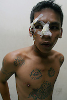 Angelito Ayson, 21, was beaten up by mistake Thursday night by bystanders on Timog Ave. after he picked up fan knife discarded by a fleeing trio of hold-up men in a failed robbery attempt on a jeepney. Ayson admitted his trade is snatching bags and cellphones, but not hold-up robbery. Photo taken at Police Station 10 on EDSA-Kamuning whose jail is now his home. 8 aug 2003