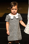Model walks runway in an outfit by Doe A Dear, during the petitePARADE Children's Club fashion show at the Jacob Javits Center in New York City, on January 9, 2016.