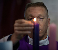 101205-N-7981E-014 PACIFIC OCEAN (Dec. 5, 2010)- Chaplain Cmdr. Keith Shuley, command chaplain of USS Carl Vinson (CVN 70), lights candles during Roman Catholic mass on Vinson's foc'sle. Carl Vinson and Carrier Air Wing 17 are currently on a three-week composite training unit exercise (COMPTUEX) followed by a western Pacific deployment. (U.S. Navy photo by Mass Communication Specialist 2nd Class James R. Evans / RELEASED)