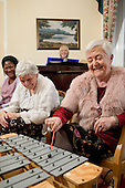 Music therapy session at Branch Hill House residential home for the elderly, Camden.