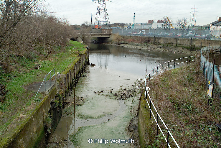 Silt, vegetation and rubbish around a derelict lock on the River Lee Navigation, which passes through the proposed site of the 2012 Olympic Games in Stratford, London.