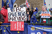 BBC Fake News Fake Views. Pro and anti Brexit protesters demonstrate outside the Houses of Parliament on the day MPs voted decisively to reject Theresa May's withdrawal deal with the EU.  Westminster, London.