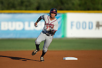 Derian Cruz (7) of the Danville Braves hustles around second base during the game against the Burlington Royals at Burlington Athletic Stadium on August 12, 2017 in Burlington, North Carolina.  The Braves defeated the Royals 5-3.  (Brian Westerholt/Four Seam Images)