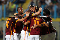 Calcio, Serie A: Frosinone vs Roma. Frosinone, stadio Comunale, 12 settembre 2015.<br /> Roma's Juan Iturbe is hidden by teammates' hugs after scoring during the Italian Serie A football match between Frosinone and Roma at Frosinone Comunale stadium, 12 September 2015. Roma won 2-0.<br /> UPDATE IMAGES PRESS/Riccardo De Luca