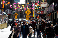 NEW YORK - NEW YORK - MARCH 21: People make their way in a local street of Chinatown on March 21, 2021 in New York. In the last two months, more than 500 attacks on Asians have been reported in United States. (Photo by John Smith/VIEWpress)