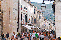 The main street Stradun Placa with traditional houses and flocks of tourists Dubrovnik, old city. Dalmatian Coast, Croatia, Europe.