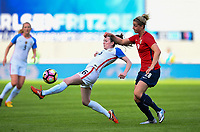 Sandefjord, Norway - June 11, 2017: Rose Lavelle and Ingrid Marie Spord in action during their game vs Norway in an international friendly at Komplett Arena.