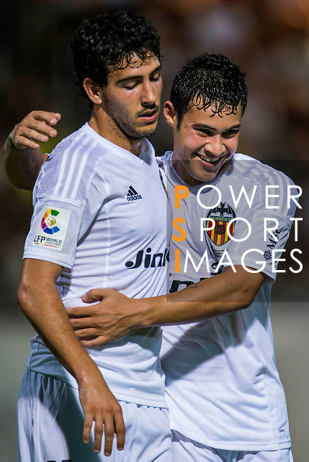 (L) Daniel Parejo of Valencia CF celebrates after scoring with (R) Vinicius Araujo of Valencia CF during LFP World Challenge 2014 between Valencia CF vs BC Rangers FC on May 28, 2014 at the Mongkok Stadium in Hong Kong, China. Photo by Victor Fraile / Power Sport Images