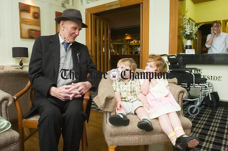 Hale and Hearty!..........Jim Keogh, Knockdonagh, Kilmore near Limerick, and originally from Sixmilebridge, who celebrated his 100th birthday on Tuesday pictured with his grand nephew Sean Keane and grand niece Kate Keane. Photograph by John Kelly.