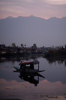 A shikara, water taxi, in early morning on Dal Lake. Srinagar, Kashmir, India. © Fredrik Naumann/Felix Features