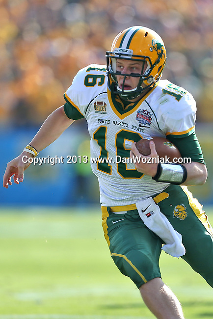 North Dakota State Bison quarterback Brock Jensen (16) in action during the FCS Championship game between the North Dakota State Bison and the Sam Houston State Bearkats at the FC Dallas Stadium in Frisco, Texas. North Dakota defeats Sam Houston 39 to 13..