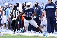 CHAPEL HILL, NC - OCTOBER 10: Javonte Williams #25 of North Carolina runs after catching the ball during a game between Virginia Tech and North Carolina at Kenan Memorial Stadium on October 10, 2020 in Chapel Hill, North Carolina.