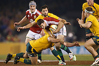 MELBOURNE, 29 JUNE 2013 - Jonathan SEXTON of the Lions is tackled by Ben ALEXANDER of the Wallabies during the Second Test match between the Australian Wallabies and the British & Irish Lions at Etihad Stadium on 29 June 2013 in Melbourne, Australia. (Photo Sydney Low / sydlow.com)