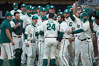 David McCabe (24) of the Charlotte 49ers is greeted at home plate after hitting a home run against the Tennessee Volunteers at Hayes Stadium on March 9, 2021 in Charlotte, North Carolina. The 49ers defeated the Volunteers 9-0. (Brian Westerholt/Four Seam Images)