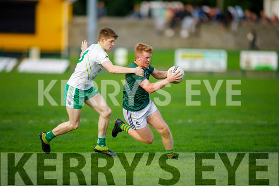 Conor O'Keefe under pressure from Brian Ó Seanacháin from Ballydonoghue v Finuge in the Junior Premier Football Championship quarter finals.