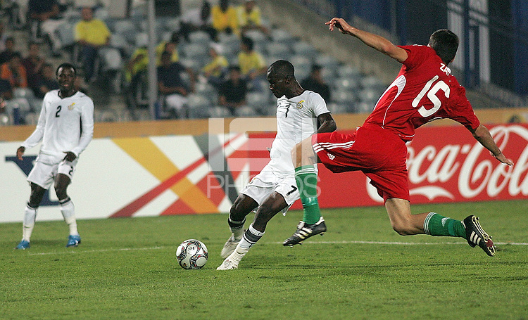 Ghana's Abeiku Quansah (7) makes a goal scoring kick past Hungary's Bence Zambo (15) during the FIFA Under 20 World Cup Semi-final match at the Cairo International Stadium in Cairo, Egypt, on October 13, 2009. Costa Rica won the match 1-2 in overtime play. Ghana won the match 3-2.