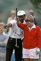 Debbie Austin lines up putt with help from caddy at the Carlton, a golf tournament on the LPGA Tour played at the Calabasas Country Club, Calabasas, California, September 1976. Photo by John G. Zimmerman.