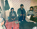 Iraq 1984 .Hama Haji Mahmoud in the village of Bani Char with a baby and villagers.Irak 1984 .Hama Haji Mahmoud dans le village de Bani Char avec un bebe et des villageois