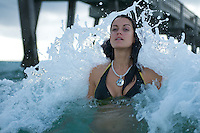 Model Deanna in the surf next to Dania Beach Pier, Florida.