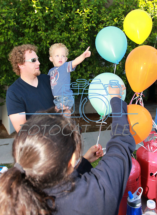 Wayne Thorley and his son Kellen, 2, get a balloon at the Carson City Library Summer Reading Program Pancake Breakfast Kick-Off, Saturday, June 9, 2012. .Photo by Cathleen Allison