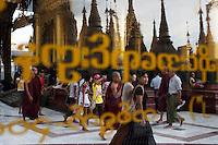 Monks and devotees visit Shwedagon Pagoda in Yangon.